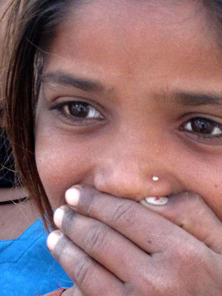 Gente, India, Gujarat, ragazzina ride rid